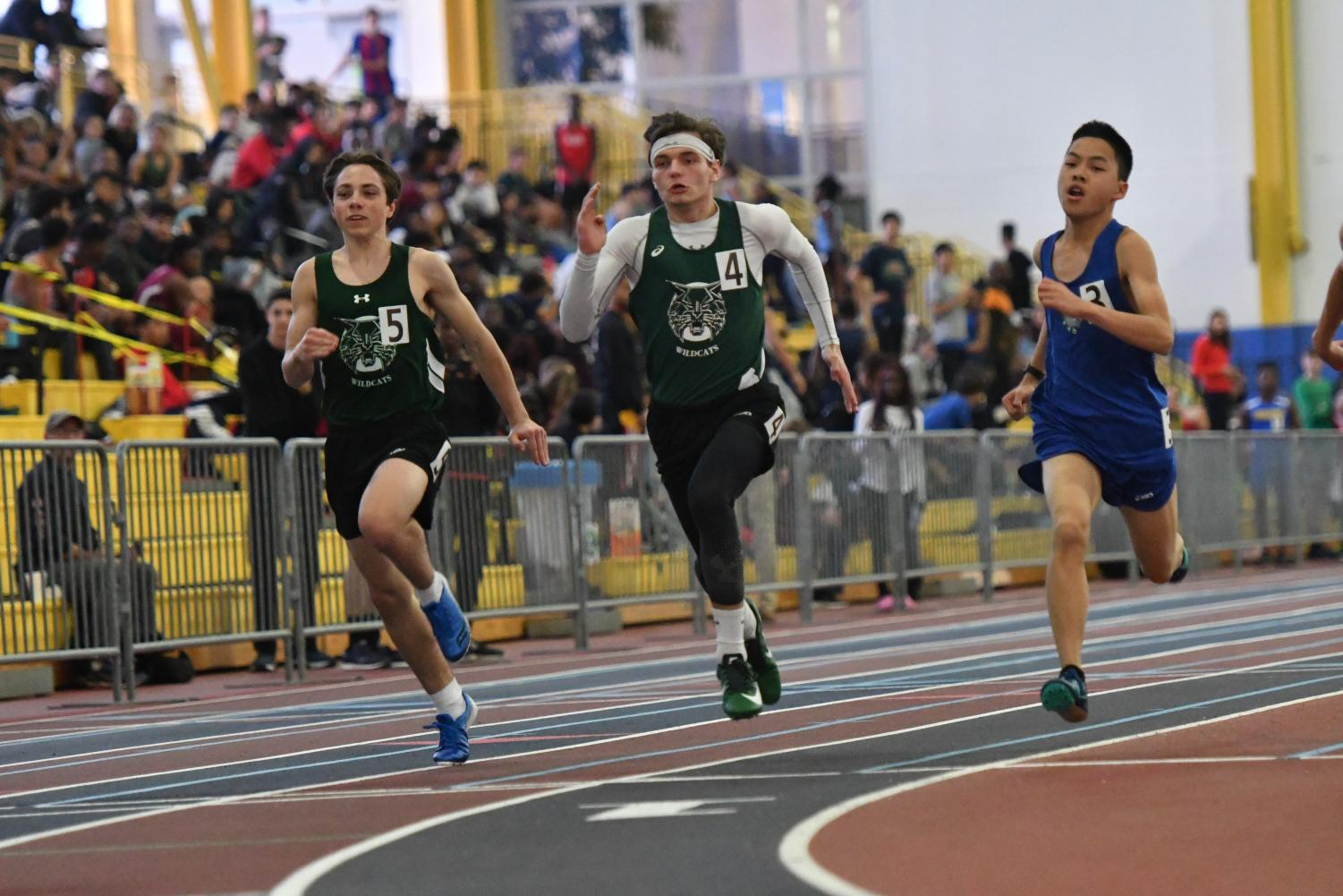 Sophomore Ben Cope (left) and Junior Declan Stablow (middle) spring into action for WJ. Both the boys and girls teams performed well at the Last Track to Philly meet and MCPS Championships.