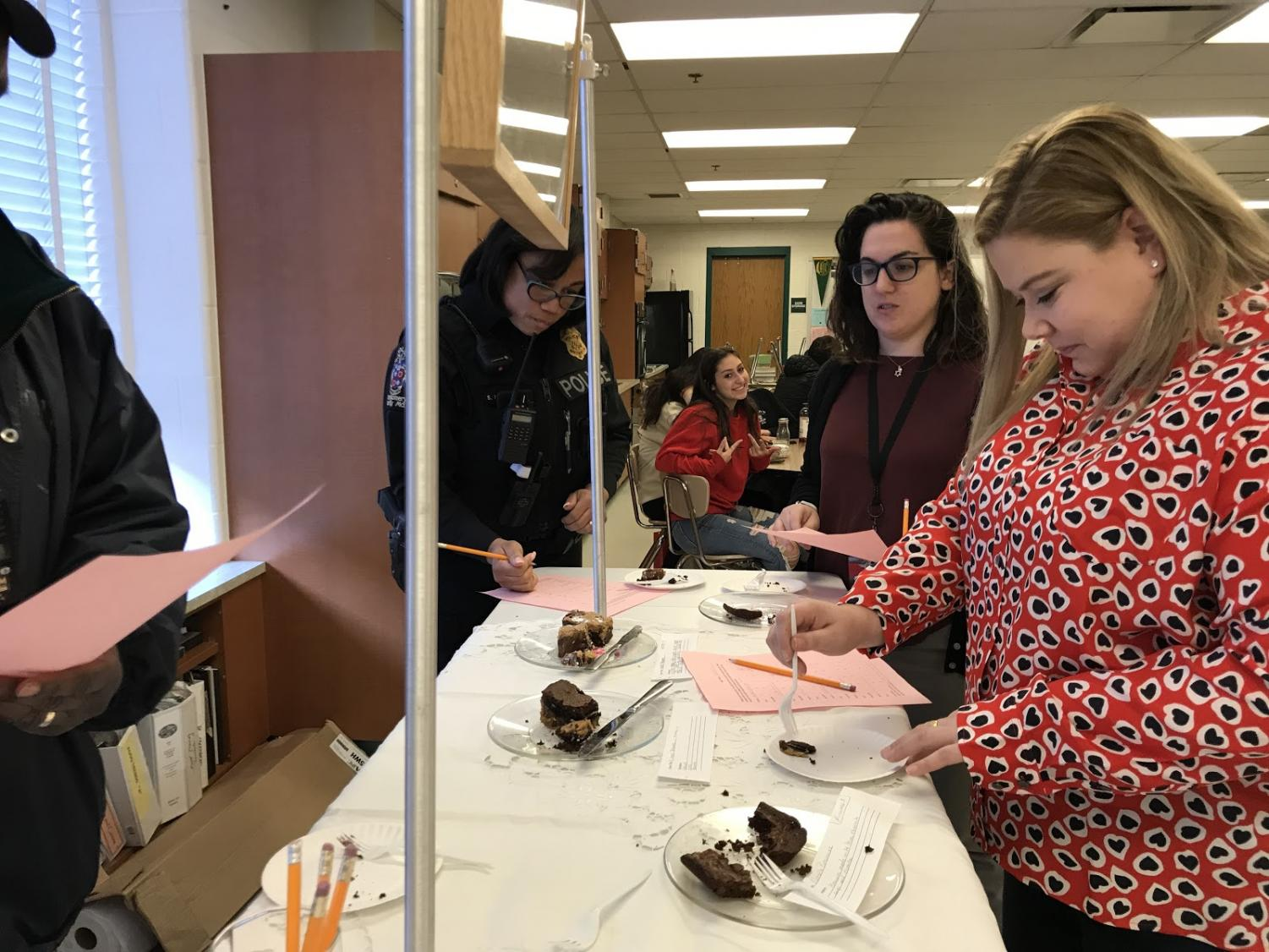 WJ+teachers+and+staff+members+who+do+not+teach+a+first+or+second+period+were+welcomed+by+the+Food+Trends+students+and+teacher+Connie+Pokress+to+taste+test+the+annual+chocolate+dessert+competition.+Students+created+a+variety+of+different+chocolate+based+dishes+such+as+cupcakes%2C+brownies+and+cakes.+%E2%80%9C%5BThe+desserts%5D+are+all+good%2C+some+are+better+than+others+but+they+all+did+a+great+job%2C%E2%80%9D+security+guard+Roy+Joyner+commented.+Photo+by+Sam+Falb