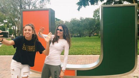 Senior Jadyn Fox poses excitedly in front of the University of Miami sign. Juniors are beginning their college search process.