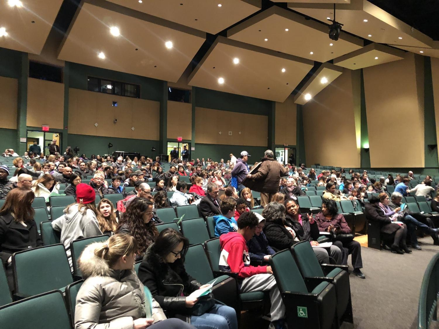 """Parents and students from the WJ community crowd the auditorium to watch the showing of the """"Like"""" documentary presented by the WJ PTSA. A Q&A was held after the viewing by counselors and professors that came to the event for parents to ask questions of the panel."""