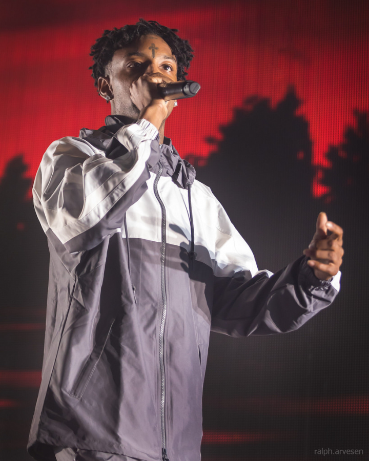 A quickshot of rapper 21 Savage as he performs at one of his many concerts in the US. His recent arrest has brought forward many followers and protests in support of his name.