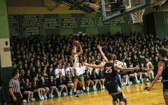 Electric home crowd powers boys basketball to victory over B-CC