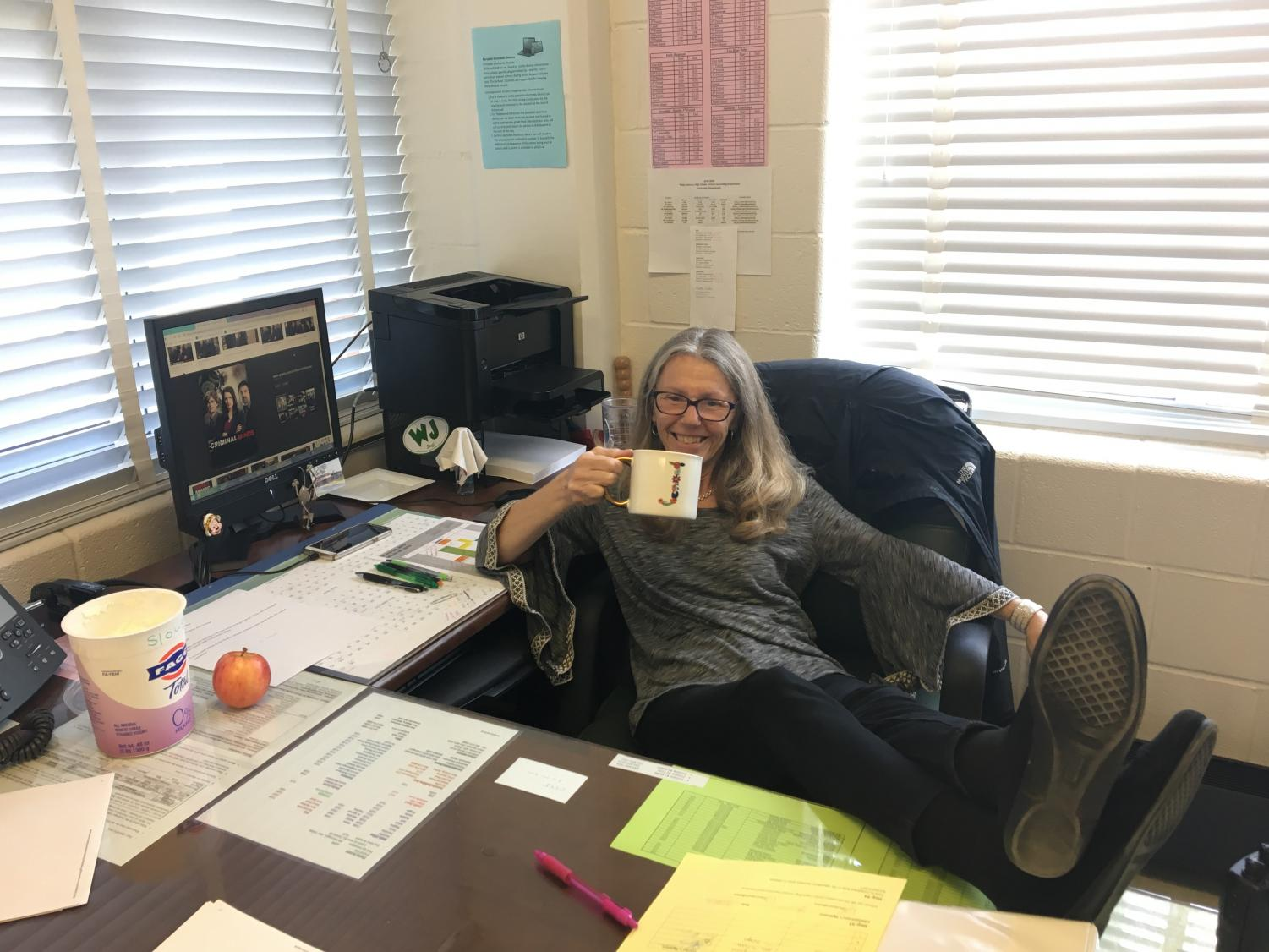 Administrator Janan Slough relaxes behind her desk instead of doing work. She is an avid fan of Criminal Minds and watches four episodes every day.