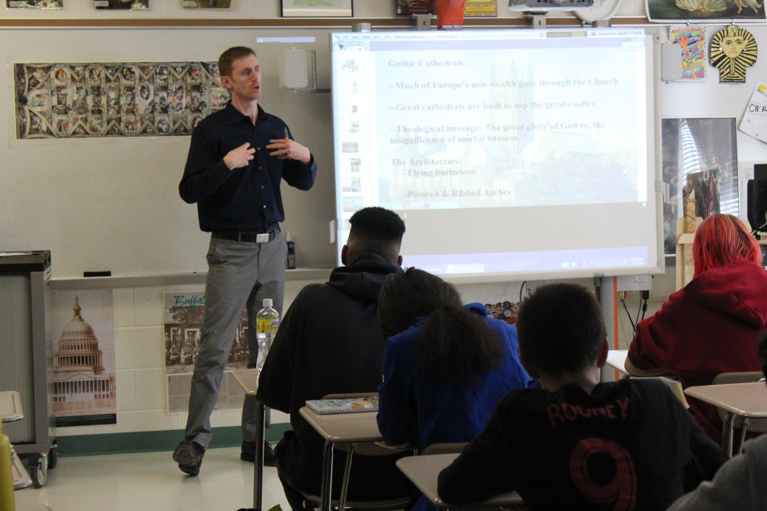 Mr. Butler lectures to his Medieval History class. Government and History teachers are often faced with task of attempting to remain unbiased.