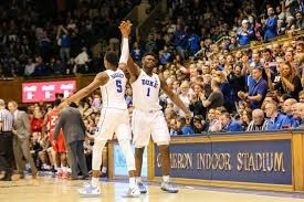 Potential number one and two draft picks Zion Williamson (#1) and RJ Barrett (#5) celebrate at a sold-out Duke basketball game.