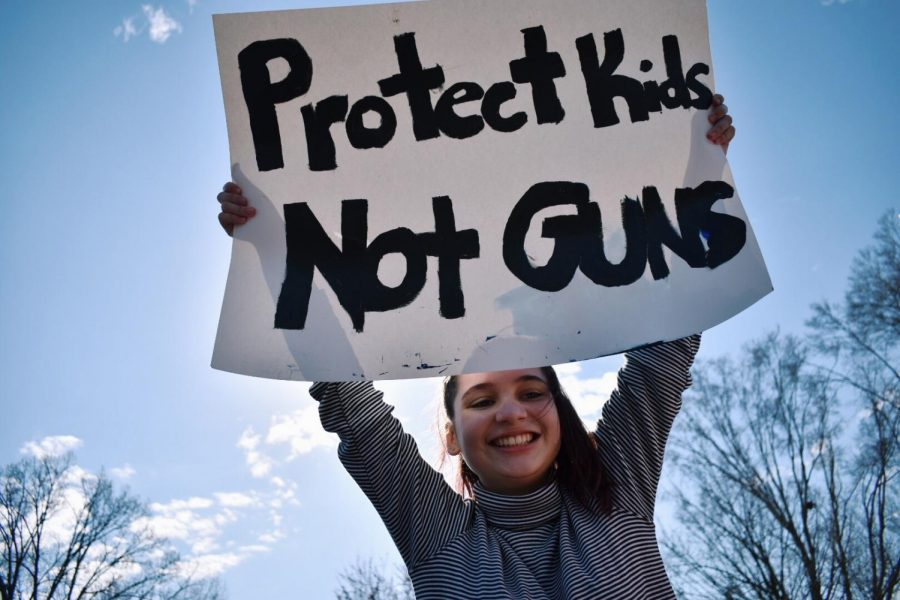 Senior+Eleanor+Wright+at+one+of+the+school+walkouts+advocating+for+gun+reform+last+year%2C+she+and+other+students+received+and+excused+absence+for+classes+during+the+protest.%0A