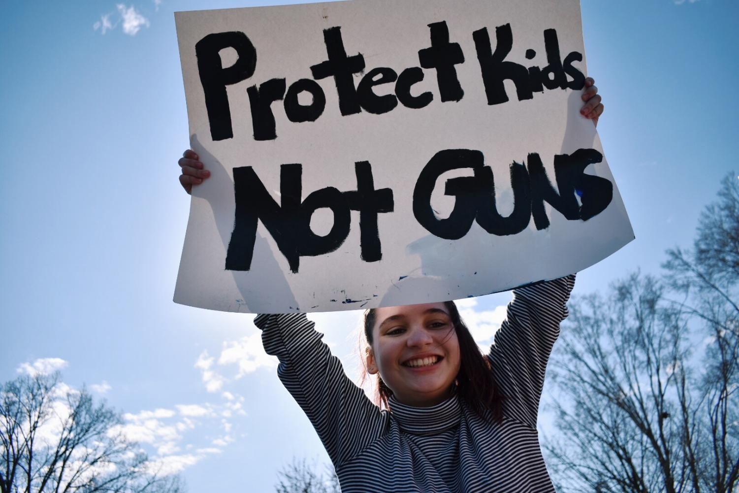 Senior Eleanor Wright at one of the school walkouts advocating for gun reform last year, she and other students received and excused absence for classes during the protest.