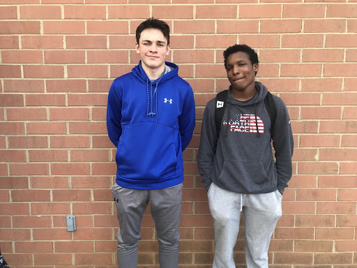 Junior Varsity defensive play Brody Ramirez (left) poses next to Varsity star Luke Hinds (right) before practice in 2018. Both wearing grey sweatpants.