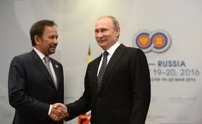 Brunei Sultan Bolkiah (left) pictured with Russian President Putin (right) at a summit in 2016. The Sultan has many connections to politicians and families of power, and is the one responsible for the new laws.