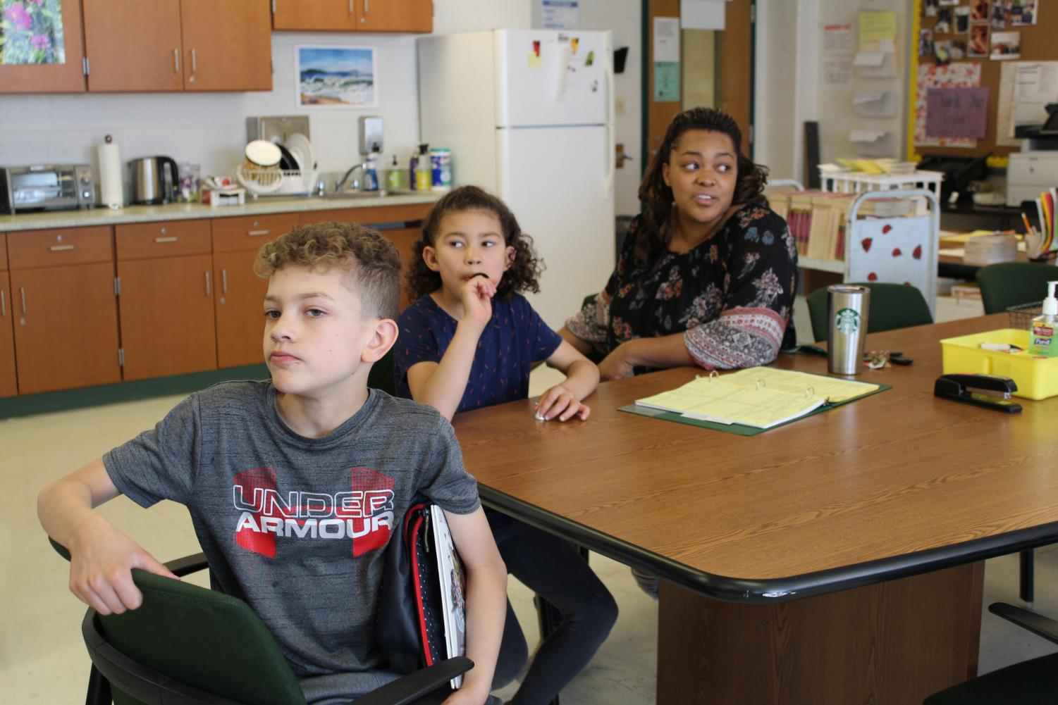 Eliana VanCuran and her children eat their lunch in the English office.