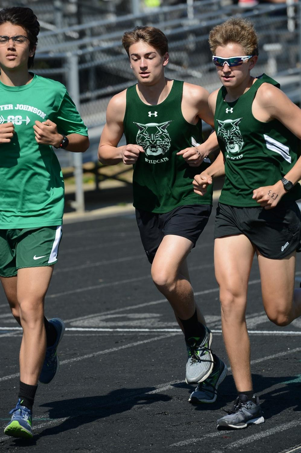 Senior Rodrigo Yepez-Lopez, sophomore Alex Scott and junior Jake Marks (pictured left to right) accelerate through a turn. This trio has led the boys team to a characteristically strong start to the season.