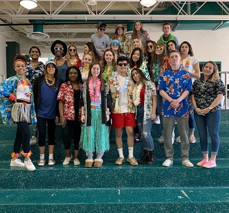 The+senior+leadership+class+rocks+their+colorful+Hawaiian+shirts+and+leis+on+Tropical+Tuesday.+This+was+one+of+the+easier+spirits+for+students+to+be+involved+in.+%0A