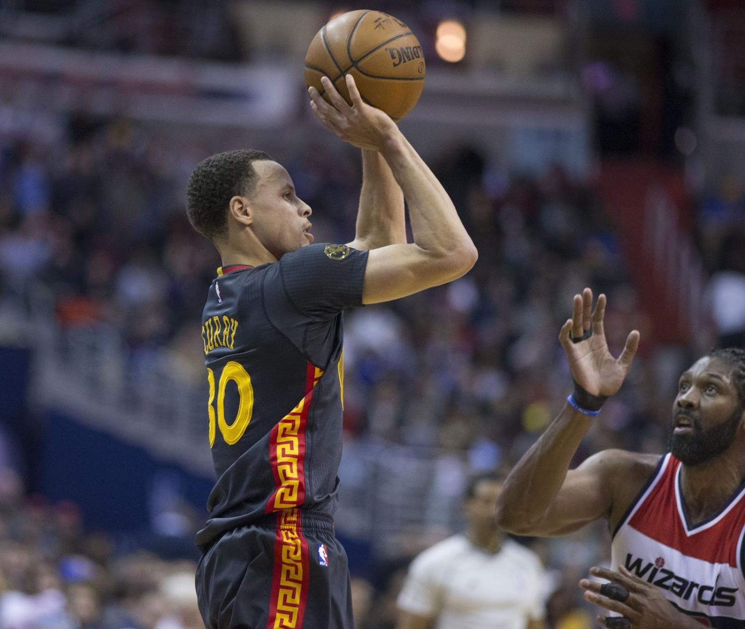 Stephen Curry takes a shot in a game against the Wizards. Curry looks to keep up his great postseason play and lead the Warriors to a third straight title.