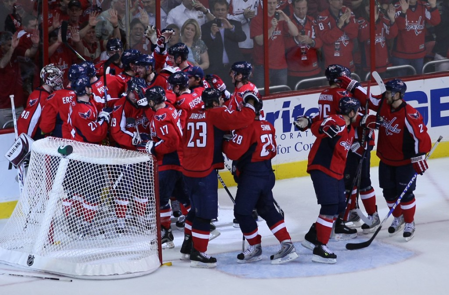 The+Capitals+celebrate+a+home+goal.+After+winning+the+Stanley+Cup+last+year%2C+the+remaining+teams+will+try+achieve+what+Ovechkin+and+the+Caps+could+not+repeat.+