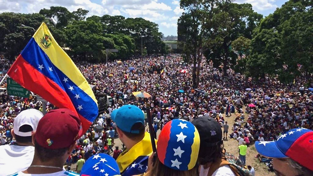 Juan Guaido supporters gather in Caracas, the capital of Venezuela.  Guaido declared himself interim president on January 23, a move that sparked controversy within and outside of the country.
