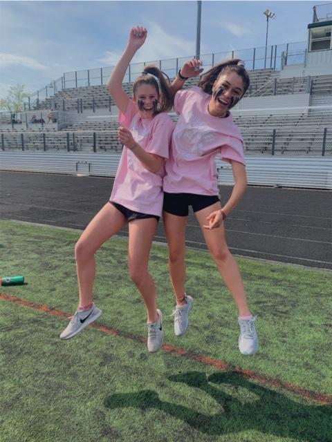 Ready+set+play.+Juniors+Kayla+Kahrl+and+Caroline+Kennon+jump+in+excitement+to+play+in+WJ%E2%80%99s+annual+Powder+Puff+game+against+the+seniors+on+May+22.+The+juniors+played+a+close+game%2C+but+ultimately+lost.
