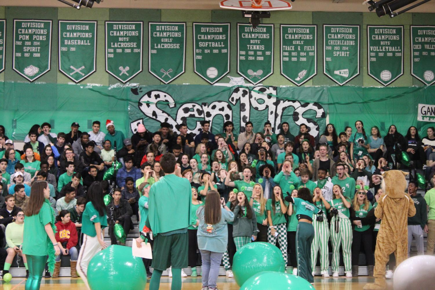 A group of students cheer at a pep rally. Some teens don't participate in school spirit because of negative feelings towards SGA sponsored events.