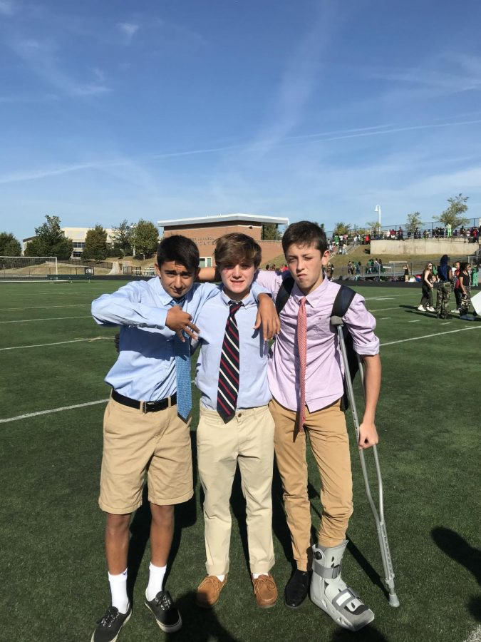 Freshmen+Bardia+Hormozi+%28left%29%2C+Sean+Blakeslee+%28middle%29%2C+and+Sammy+Gramlich+%28right%29%2C+complete+their+very+first+high+school+pep+rally.