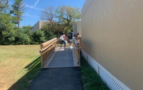 Students are seen walking to their sixth period portable class. The walk to class can be warm with sunny weather outside, but this isn't always the case, making the portables inconvenient for some students.
