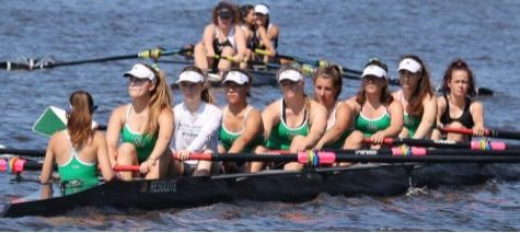 Nine girls on the varsity girls team race down the river at a regatta. Succeeding in regattas during competition seasons is critical for sending a boat to Nationals.