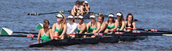 Nine+girls+on+the+varsity+girls+team+race+down+the+river+at+a+regatta.+Succeeding+in+regattas+during+competition+seasons+is+critical+for+sending+a+boat+to+Nationals.