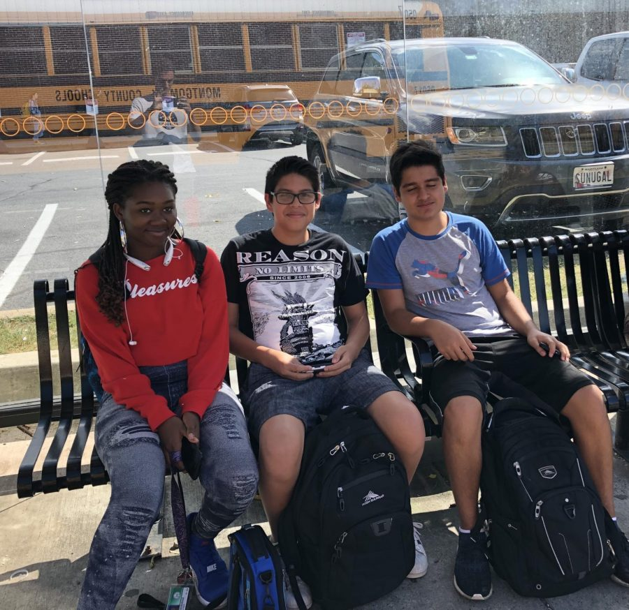 Students wait at the Ride On stop outside of Georgetown Square. A significant amount of WJ students use the bus for after-school transportation, which is already free with a student ID.