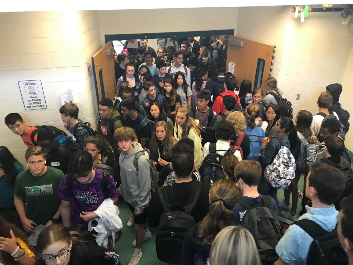 Students transition to their Period four class. Crowded hallways and stairwells have been a topic among students after the narrow stairwells have been turned into down only and more portables have been added.