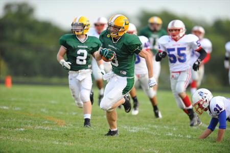 A Damascus football player sprints up the field during a game. The Damascus football program has been under fire lately, having to forfeit their first game of the season due to the holding of an illegal practice.