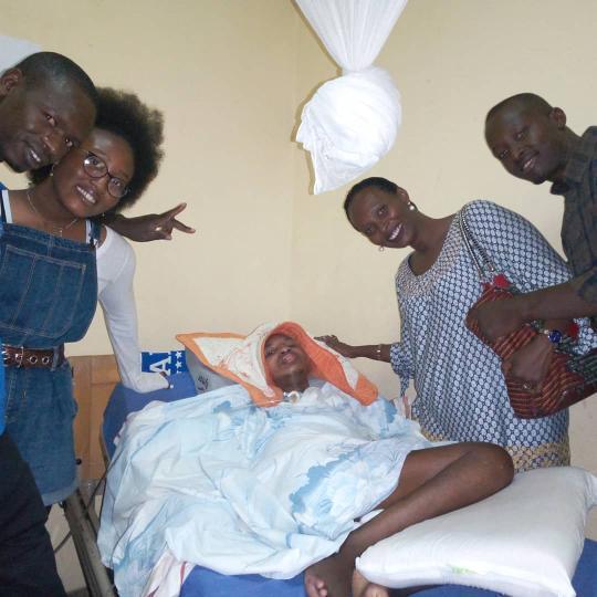 Shiima Nantulya and her mother visit a hospital in Rwanda where they meet a paralyzed boy named Trésor who's story changed Nantulya's life forever.  (Left to right) Rwandan nurse, Shiima Nantulya, Tresor, Carine Kaneza , Fabrice.