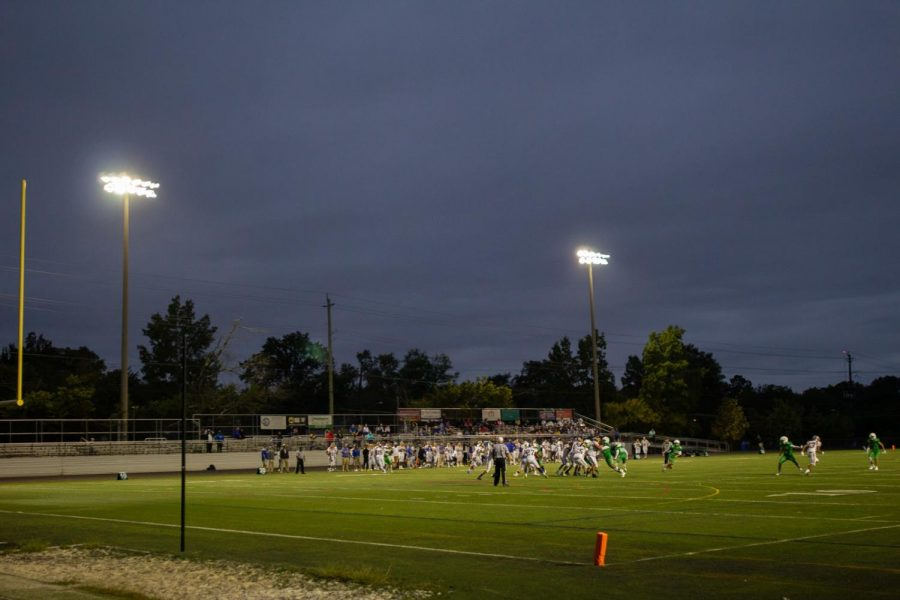 Friday+night+lights+shine+down+on+the+players+as+WJ+football+takes+on+Gaithersburg+at+home.+WJ%E2%80%99s+turf+field+is+set+to+be+replaced+at+the+end+of+the+season.
