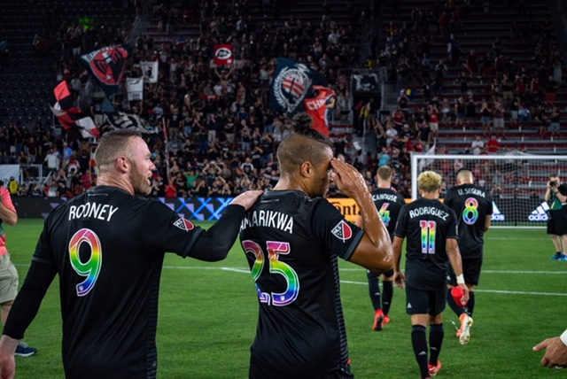 D.C.+United+forward+Quincy+Amarikwa+strolls+towards+the+stands+with+teammate+Wayne+Rooney+after+a+game.+The+pair+have+helped+D.C.+United+reach+playoff+birth+this+season.