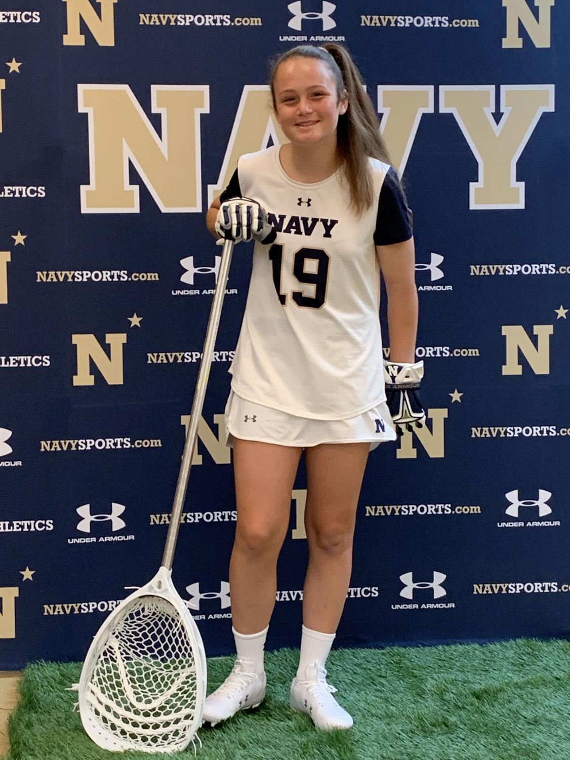 Junior  lacrosse player Emma Richardell poses in her new Navy gear. After she finishes her education, she will be in the US Navy for five years.