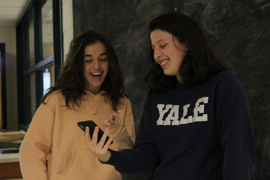 Senior Sarah Kuziora and sophomore Adiar Bell watch old vines during Art and Culture. They were amused by the iconic