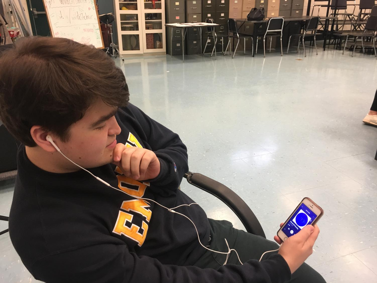 Senior Damir Pimenov listening to