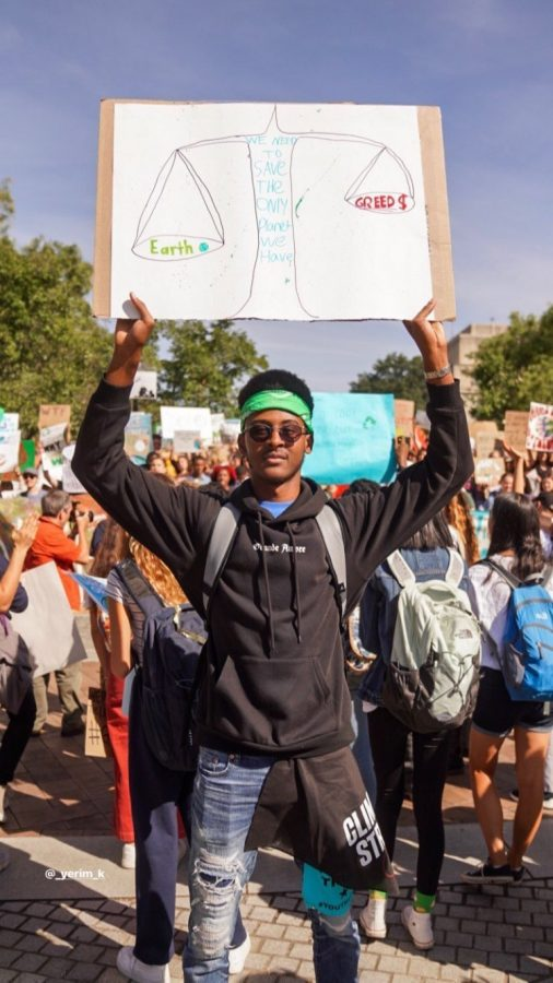 Senior Yerim Kone holds up a sign expressing his frustration with the government and how they are handling climate change during the massive protest.