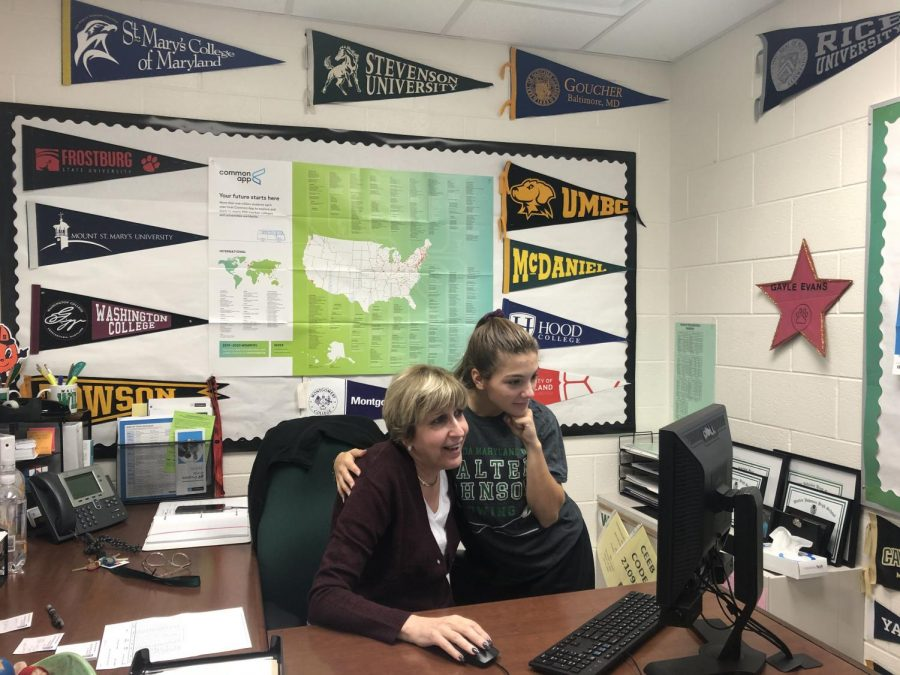 Ms. Evans shows senior Sophie Difrank information on the college she's planning on attending. Evans is always willing to lend a hand when it comes to finding the job or college that's right for you.