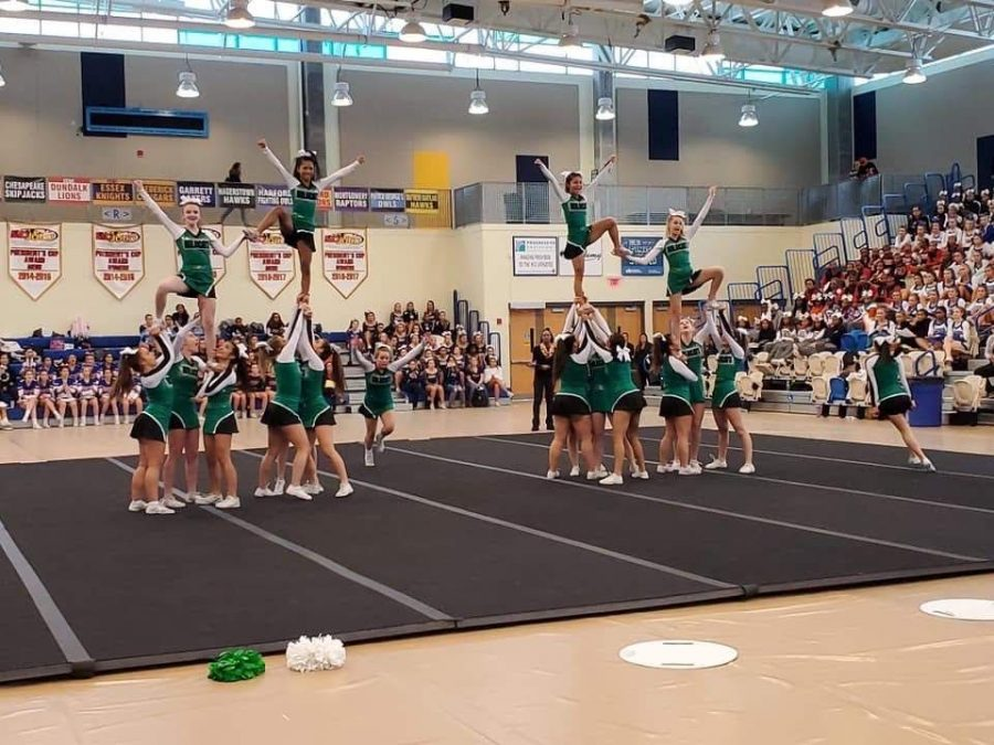 The cheer team proves they are a pro at stunts.