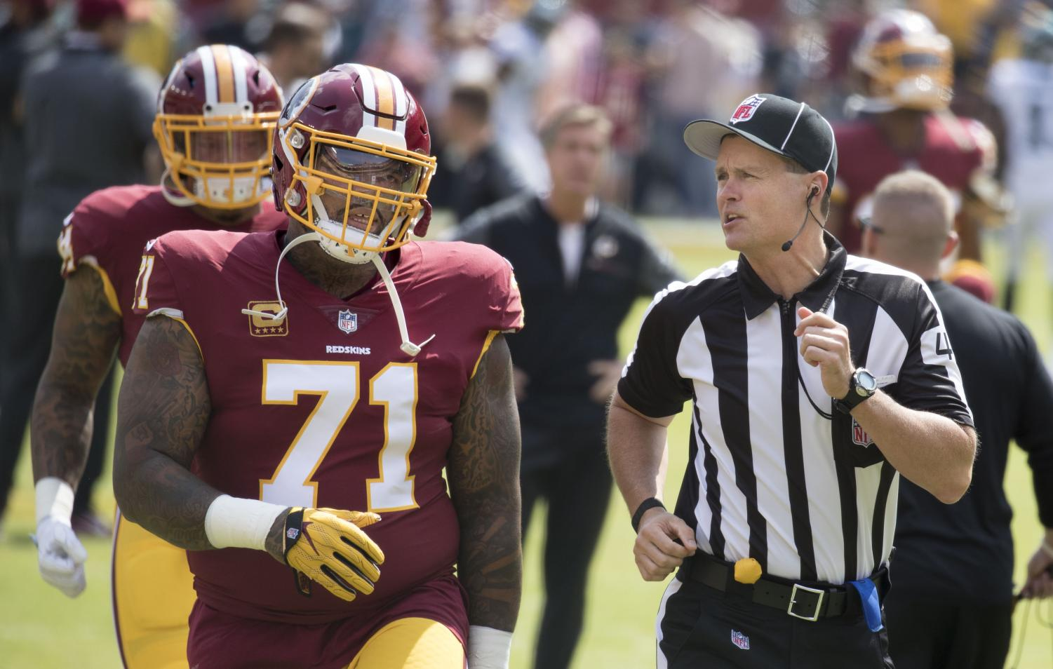 Longtime Redskins captain and fan favorite Trent Williams speaks to an official during a game. After a medical misdiagnosis, Williams has not played this season for the Redskins and has vowed to never return.