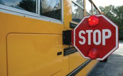 School buses are equipped with stop signs, red flashing lights and cameras. The driver stayed on the scene after the incident.