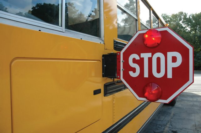 School+buses+are+equipped+with+stop+signs%2C+red+flashing+lights+and+cameras.+The+driver+stayed+on+the+scene+after+the+incident.