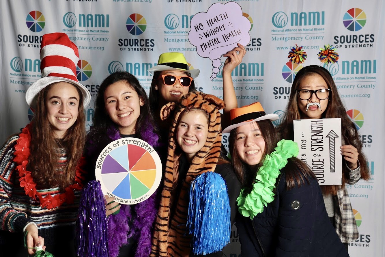 Juniors Emmie Maisel, Mia Chai, Victoria Rentsch, Nicole Uhl, Ella Mochizuki and Amber Liang pose for a mental health-themed photo booth. This event was hosted by Sources of Strength as a fun activity for students during Mental Health Week.