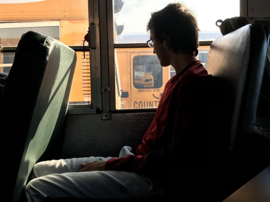 Junior Kai Svenson looks out the window on an MCPS bus. Over the next few years, seatbelts will be added in either the lap or shoulder position.