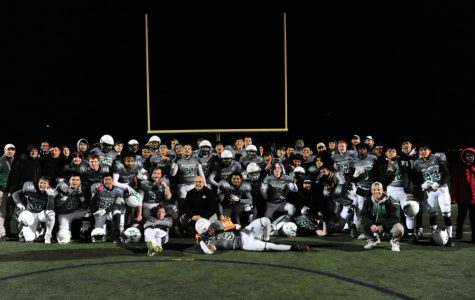 The varsity football team poses for a picture following their 42-10 win in the first round of the playoffs against Urbana on Friday, November 8th.