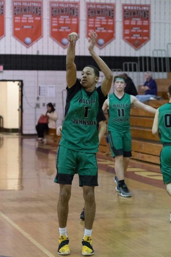 Mikel Fornwald takes a shot on the court at Quince Orchard High School in what ended up a 69-64 WJ win.