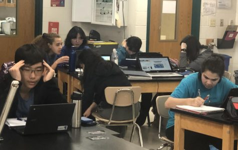 Members of Science Olympiad prep for their competition in study groups by events.The event