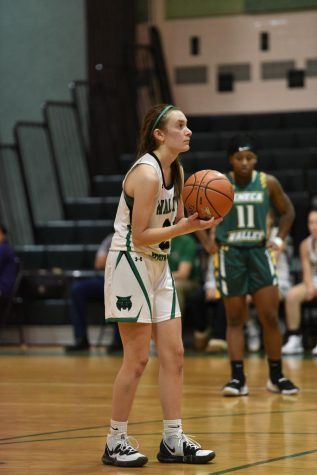 Sophomore Alexa Hackmann lines up for a free throw against the Seneca Valley High School Eagles. Hackmann started the season on JV, but due to the struggling varsity team, was pulled up in mid December.