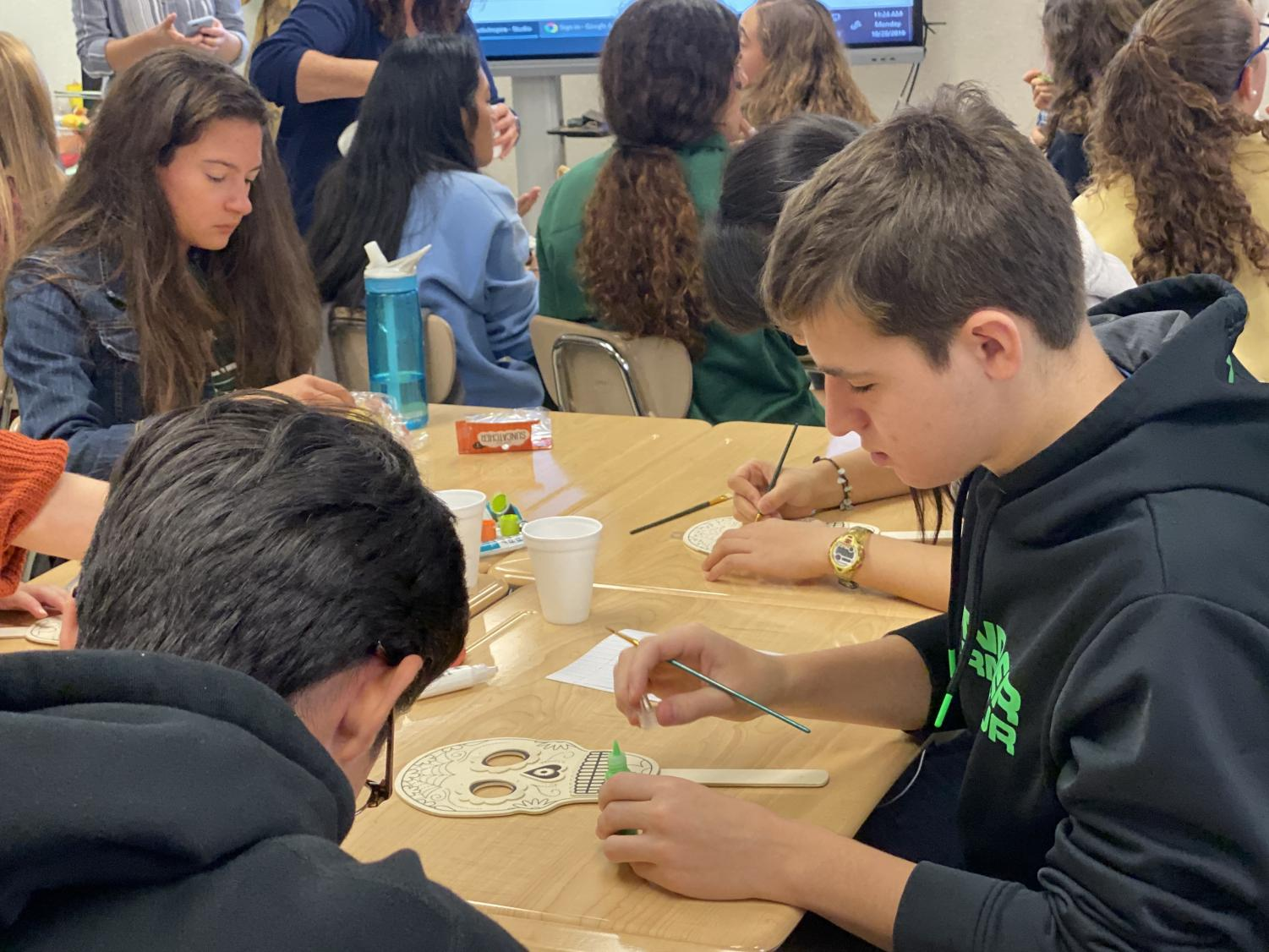 Spanish Honor Society students work on an arts and crafts project. The group has tried to emphasize cultural activities to enhance the experience of members.