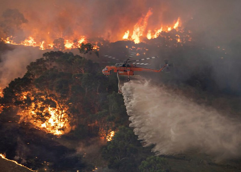 In+this+Monday%2C+Dec.+30%2C+2019+photo+provided+by+State+Government+of+Victoria%2C+a+helicopter+tackles+a+wildfire+in+East+Gippsland%2C+Victoria+state%2C+Australia.+Wildfires+burning+across+Australias+two+most-populous+states+trapped+residents+of+a+seaside+town+in+apocalyptic+conditions+Tuesday%2C+Dec.+31%2C+and+were+feared+to+have+destroyed+many+properties+and+caused+fatalities.+%28State+Government+of+Victoria+via+AP%29