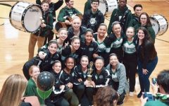 The Poms pose with the drum-line after their third place win at the Damascus Invitational competition.