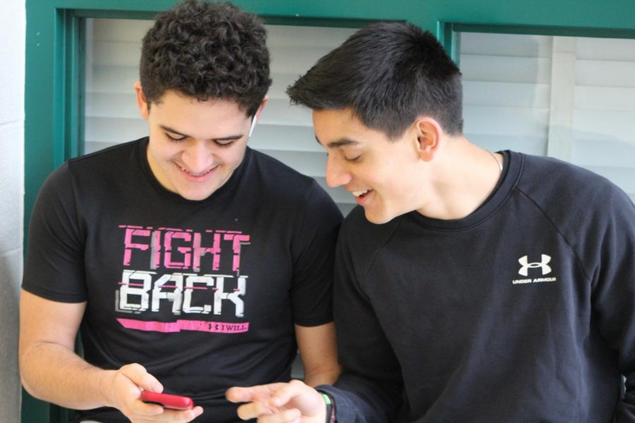 Juniors Arun Sen and Enzo Molina enjoy listening to music and frequently bond over each other's music taste.